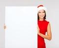 Woman In Santa Helper Hat With...