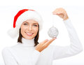 Woman in santa helper hat with christmas ball winter people happiness concept tree decoration Royalty Free Stock Photo