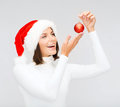 Woman in santa helper hat with christmas ball winter people happiness concept tree decoration Royalty Free Stock Photography