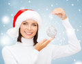Woman in santa helper hat with christmas ball winter people happiness concept tree decoration Royalty Free Stock Image