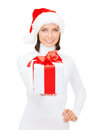 Woman in santa helper hat holding gift box christmas xmas winter and hapiness concept smiling Stock Photography