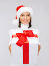 Woman in santa helper hat holding gift box christmas xmas winter and hapiness concept smiling Royalty Free Stock Image