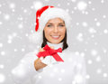 Woman in santa helper hat with jingle bells christmas x mas winter happiness concept smiling Royalty Free Stock Photo