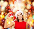 Woman in santa helper hat with jingle bells christmas x mas winter happiness concept smiling Stock Images