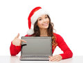 Woman in santa helper hat with laptop computer christmas x mas electronics gadget concept smiling blank screen Stock Images