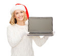 Woman in santa helper hat with laptop computer christmas x mas electronics gadget concept smiling blank screen Stock Image