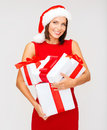 Woman in santa helper hat with many gift boxes christmas x mas winter happiness concept smiling Royalty Free Stock Photos