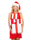 Woman in santa helper hat with many gift boxes christmas x mas winter happiness concept smiling Royalty Free Stock Photo