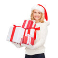 Woman in santa helper hat with many gift boxes christmas x mas winter happiness concept smiling Royalty Free Stock Image