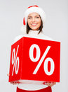Woman in santa helper hat with percent sign shopping sale gifts christmas x mas concept smiling Stock Image