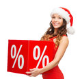 Woman in santa helper hat with percent sign shopping sale gifts christmas x mas concept smiling Royalty Free Stock Image