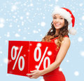 Woman in santa helper hat with percent sign shopping sale gifts christmas x mas concept smiling Stock Photography
