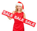 Woman in santa helper hat with red sale sign shopping gifts christmas x mas concept smiling Stock Photos