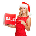 Woman in santa helper hat with red sale sign shopping gifts christmas x mas concept smiling Royalty Free Stock Photo