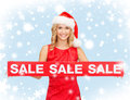 Woman in santa helper hat with red sale sign shopping gifts christmas x mas concept smiling Royalty Free Stock Images