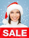 Woman in santa helper hat with red sale sign shopping gifts christmas x mas concept smiling Royalty Free Stock Image