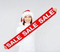 Woman in santa helper hat with red sale sign shopping gifts christmas x mas concept smiling Royalty Free Stock Photography
