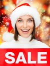 Woman in santa helper hat with red sale sign shopping gifts christmas x mas concept smiling Royalty Free Stock Photos
