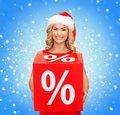 Woman in santa helper hat with red sale sign shopping gifts christmas x mas concept smiling percent Royalty Free Stock Images