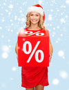 Woman in santa helper hat with red sale sign shopping gifts christmas x mas concept smiling percent Royalty Free Stock Photo