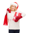 Woman in santa helper hat with shopping bags sale gifts christmas x mas concept smiling and gift boxes Royalty Free Stock Photos