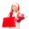 Woman in santa helper hat with shopping bags sale gifts christmas x mas concept smiling and gift boxes Stock Images