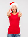 Woman in santa helper hat showing thumbs up christmas x mas winter happiness concept Royalty Free Stock Photo