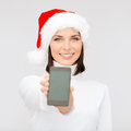 Woman in santa helper hat with smartphone christmas x mas electronics gadget concept smiling blank screen Stock Image
