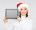 Woman in santa helper hat with tablet pc christmas x mas electronics gadget concept smiling blank screen Stock Images