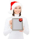 Woman in santa helper hat with tablet pc christmas x mas electronics gadget concept smiling blank screen Royalty Free Stock Photography