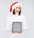 Woman in santa helper hat with tablet pc christmas x mas electronics gadget concept smiling blank screen Stock Image