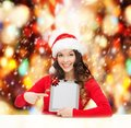 Woman in santa helper hat with tablet pc christmas x mas electronics gadget concept smiling blank screen Royalty Free Stock Photo