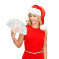 Woman in santa helper hat with us dollar money christmas x mas sale banking concept smiling Royalty Free Stock Photography