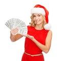 Woman in santa helper hat with us dollar money Royalty Free Stock Photo
