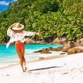 Woman with sarong on beach at seychelles anse intendance mahe Royalty Free Stock Images
