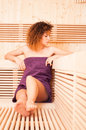 Woman in a sauna enjoing and taking a beauty treatment Royalty Free Stock Photo