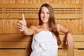 Woman in sauna holding thumbs up Royalty Free Stock Photos