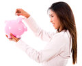 Woman saving money business in a piggybank isolated over white Stock Image