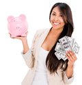 Woman saving money in a piggybank isolated over white background Royalty Free Stock Photos