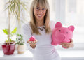 Woman saving money smart and happy for the first down payment Stock Photography