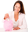 Woman saving in a piggybank Stock Photos