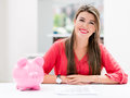 Woman saving in a piggybank happy money Royalty Free Stock Image