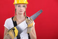 Woman with a saw Stock Photo