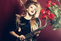 Woman with sax and roses Royalty Free Stock Photo