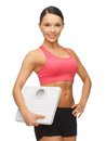 Woman with scale picture of beautiful sporty Stock Photos