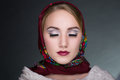 Woman in a scarf beautiful muslim caucasian russian girl traditional pavlo posad design wearing red clothes Royalty Free Stock Photography