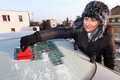 Woman scraping car window Royalty Free Stock Image
