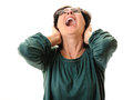 Woman scream or surprise laughing screaming with opened mouth looking up hands on neck isolated on white background Royalty Free Stock Photography