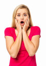 Woman screaming against white background portrait of shocked vertical shot Stock Image