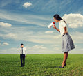 Woman screaming at small man on the field dissatisfied women men Royalty Free Stock Photography